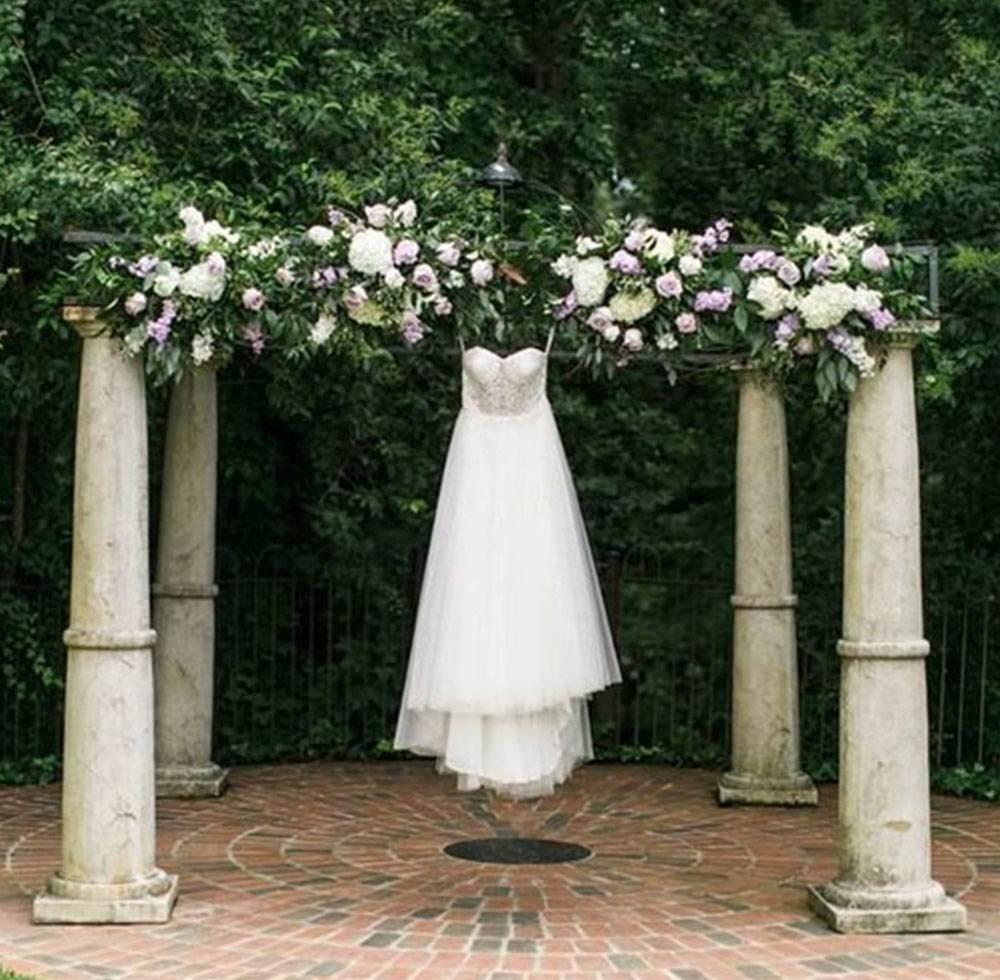 wedding dress hanging outdoors